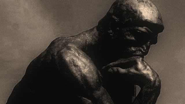 head and shoulders of the Thinker sculpture