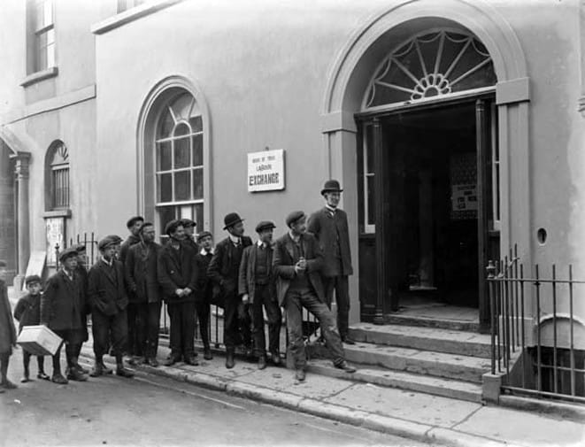 Men and boys in line outside a building