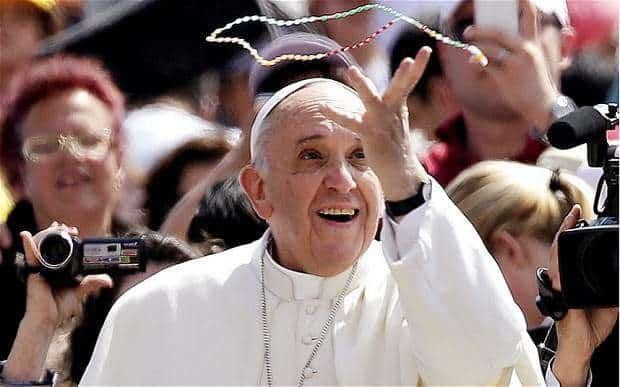 Pope Francis with a rosary