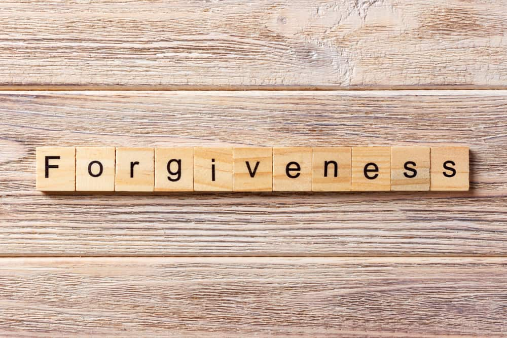 "The word ""forgiveness"" on a board"