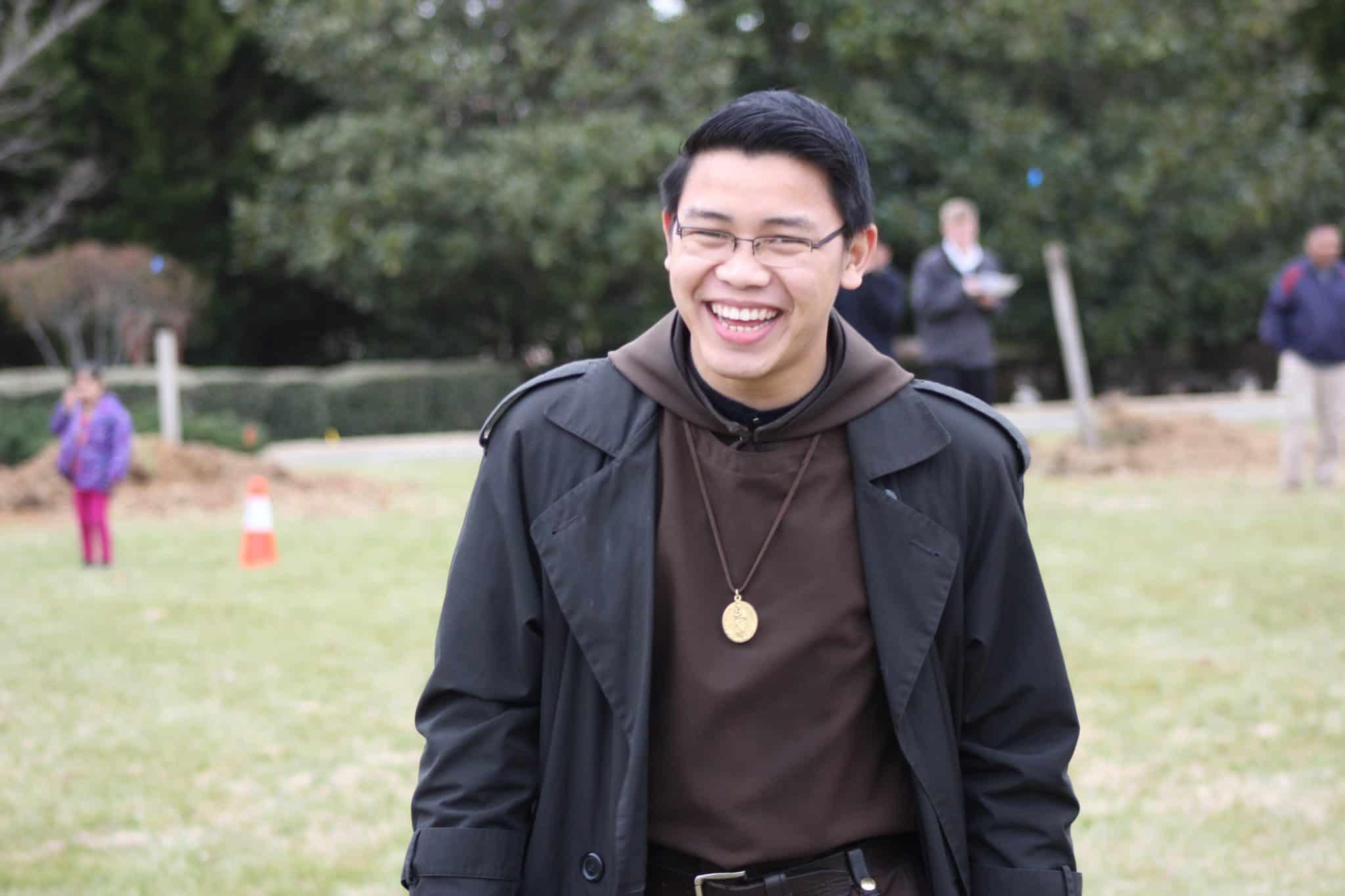Br. John grinning