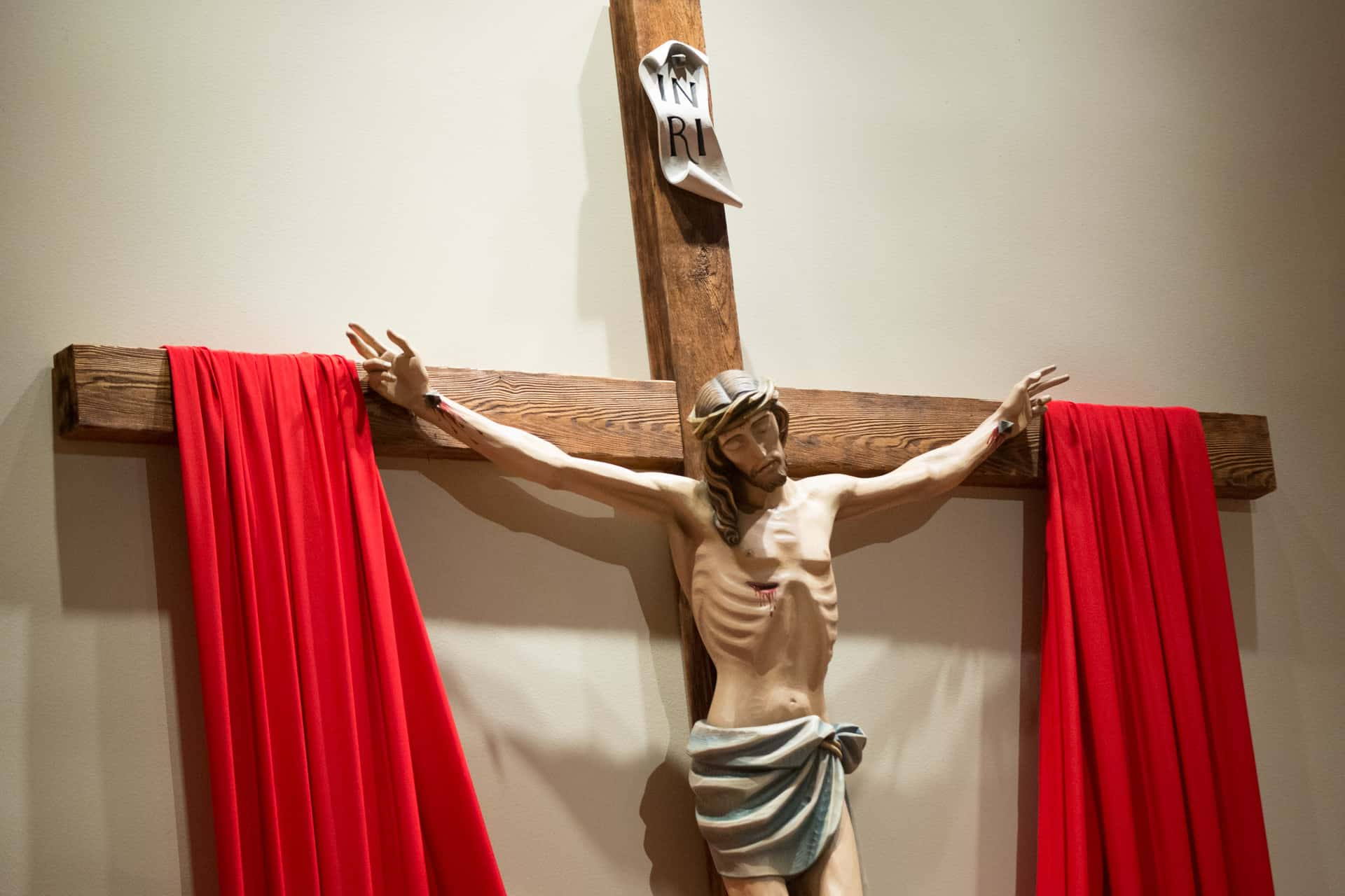 Crucifix with red cloth draped on it