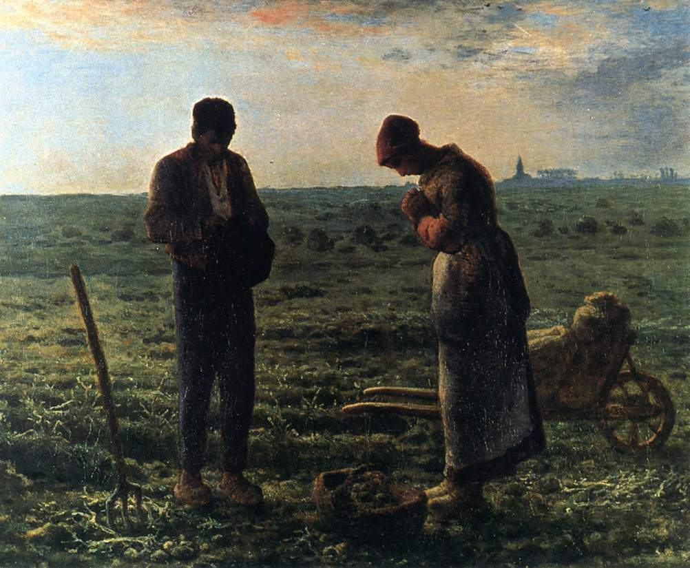 Couple in the fields bowing their heads in prayer