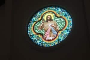 stained glass window of Divine Mercy image